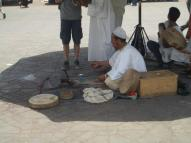 Snake charmer in the main square