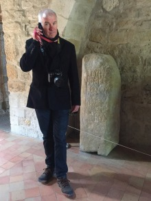 Mark beside an ancient Roman 'Mile-Stone'.