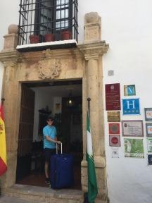Mark with luggage at Hotel San Gabriel.