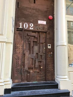 Squatters put this door together from bits of discarded junk. Now featured art in Soho