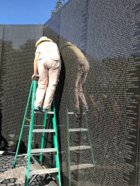 The Vietnam memorial; guides do rubbings of names
