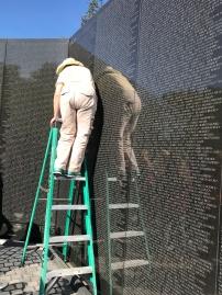 The Vietnam memorial; guides do rubbings of names