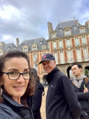 Us along the walking tour at Place de Vosges